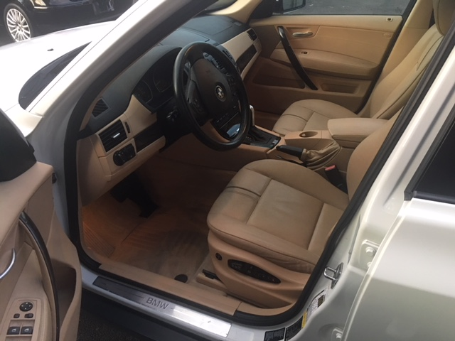 bmw-x3-white-drivers-side-front-interior-view