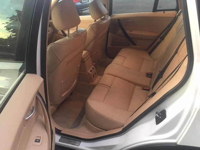 bmw-x3-white-drivers-side-rear-interior-view