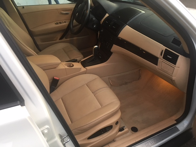 bmw-x3-white-passenger-side-front-interior-view